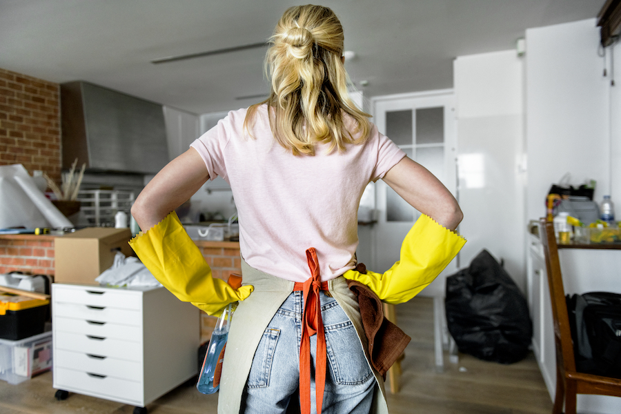 Woman cleaning the house