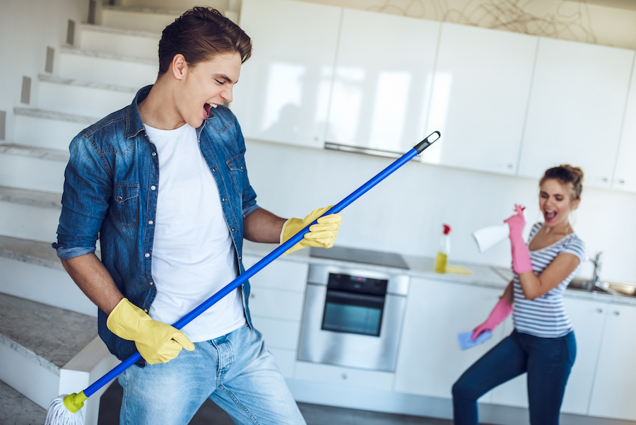 Couple is doing cleaning at home.